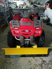 red and grey ride-on ATV