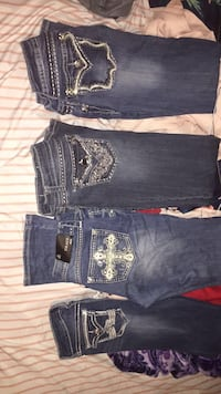 two blue and black denim jeans London, 72847