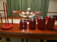Four red ceramic canisters