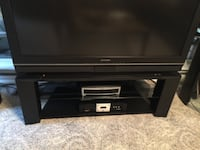 black wooden TV stand with flat screen television null