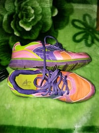 pair of pink-and-green Nike running shoes Lafayette, 47904