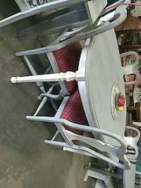 white and gray metal framed folding chair