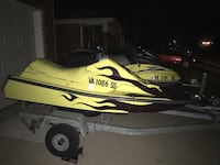 two yellow personal watercrafts