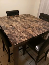 Brown table and 4 chairs dinette set