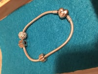 Pandora bracelet comes with three charms make an offer
