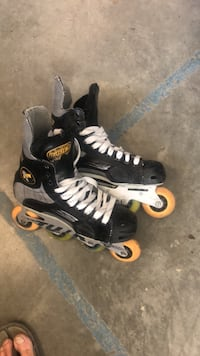 pair of black-and-white inline skates Saanichton, V8M 1L4