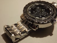 round black chronograph watch with silver link bracelet 22312