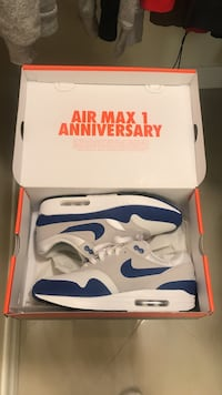pair of white-and-blue Nike Air Max 1 Anniversary shoes with box