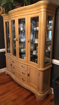 brown wooden china cabinet with glass display cabinet