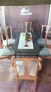 brown wooden framed glass top dining table set