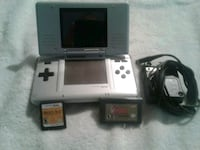 white Nintendo DS with game cartridge West Kelowna, V4T 1B4