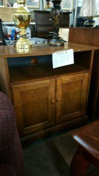 brown wooden TV stand with flat screen television Little Rock, 72209