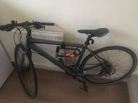 Black and blue full suspension mountain bike London, NW7 3LP