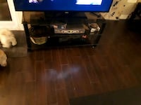black flat screen TV with black wooden TV stand Burlington, L7P 2Z9