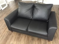 2 black leather couches Charlotte, 28217
