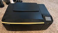 Black and yellow Kodak all-in-one printer and scanner