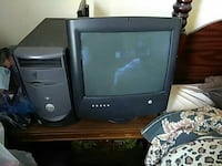 CRT monitor and gray Dell computer tower