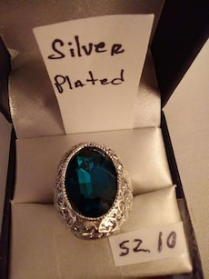 silver plated with blue gem stone embedded ring in box