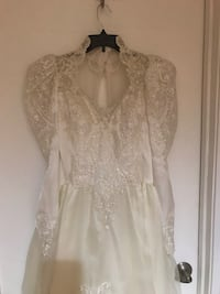 Women's off white beaded wedding gown with long train, veil and crinoline  21 km
