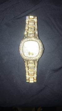 round gold-colored analog watch with link bracelet 226 mi