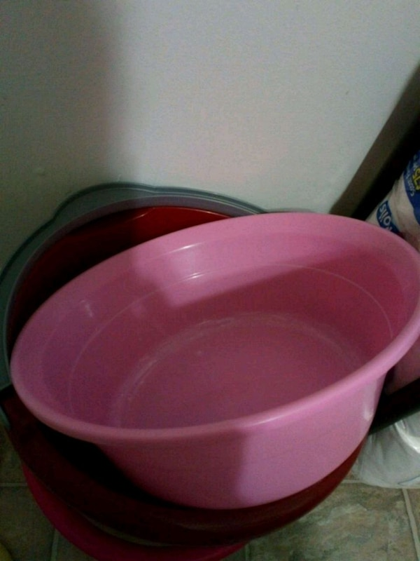 pink and black plastic container