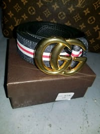 gold-colored Gucci buckle with brown leather belt Davie