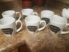 six black and white ceramic mugs