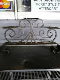 gray metal scrolled 3-piece candle holder