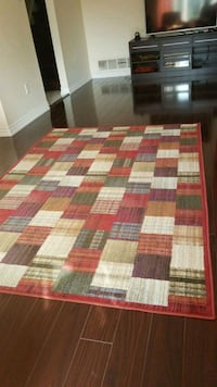 red, white, and brown area rug Brampton, L6V 2W3