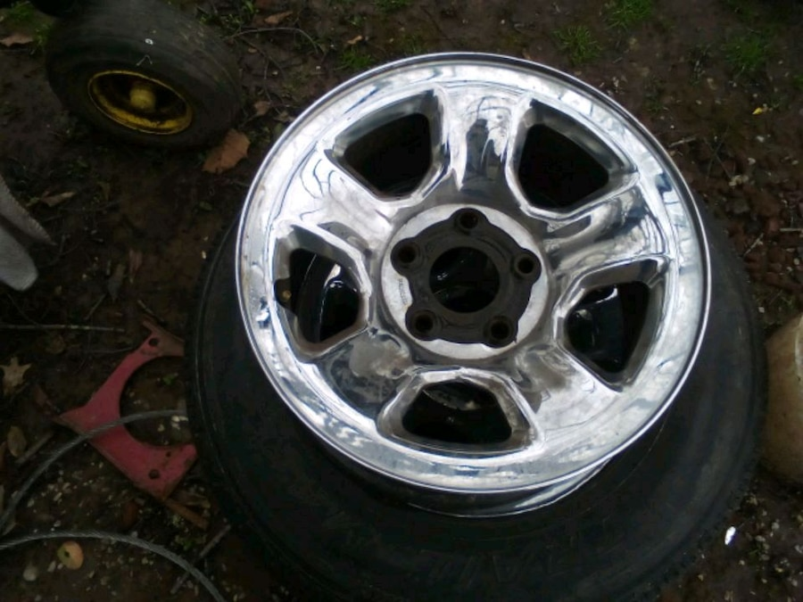 Photo 2 /17 inch /5 lug dodge wheels one with a good tire