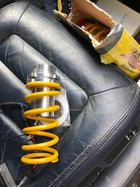 yellow and stainless steel shock absorbers 48 km