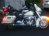 White and black touring motorcycle Hilton, 14468