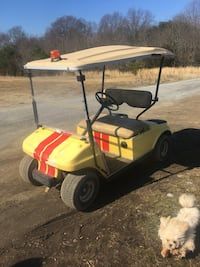 yellow and black golf cart