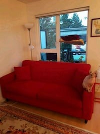 red fabric sofa with throw pillows Vancouver, V5N 2K4