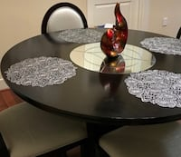 round brown wooden pedestal table Houston, 77056