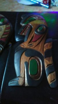 Native carvings. All three one Ravin one Salmon on