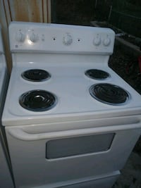 white and black 4-coil range oven 38 km