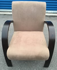 Wood framed beige padded armchair. never used but has a few scratches from storage (as seen in picture)