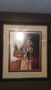 black haired girl painting with brown wooden frame Long View, 28601