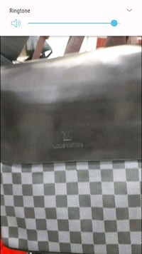 black and white checked Burberry wallet Montréal, H3N 2R6