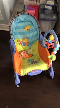 baby's yellow and blue Fisher-Price bouncer Vaughan, L4J 0G5