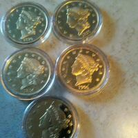 four silver and gold coins Johnson, 05656