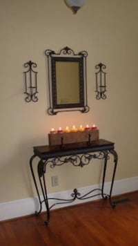 Console table, matching mirror, and wall mounted candle holders