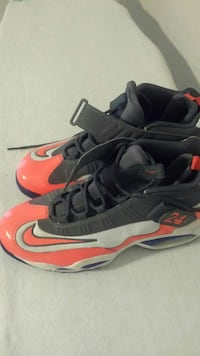 pair of black-and-red Nike basketball shoes Houston, 77077