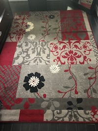 brown, red, and black floral area rug