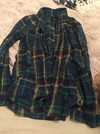 Green and yellow plaid flannel shirt that brand name American Eagle