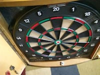 Hanging dartboard, missing some of the darts Parkville, 21234