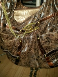 Rustic brown throw back purse. (Rocawear) Florissant, 63031