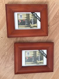 Two brown wooden framed photo frames