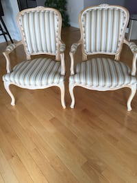two white-and-gray stripe sofa chairs